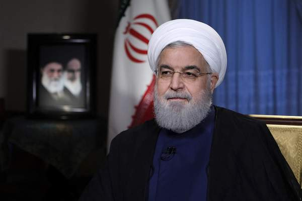 FILE - In this Monday, Aug. 6, 2018 file photo released by official website of the office of the Iranian Presidency, President Hassan Rouhani addresses the nation in a televised speech in Tehran, Iran. (Iranian Presidency Office via AP, File)