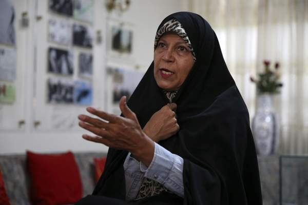 In this Thursday, Sept. 6, 2018 photo, Faezeh Hashemi, the activist daughter of Iran's late President Akbar Hashemi Rafsanjani, speaks in an interview with The Associated Press, in Tehran, Iran. (AP Photo/Vahid Salemi)