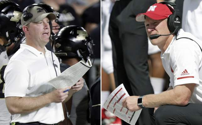 FILE - At left, in a Sept. 15, 2018, file photo, Purdue head coach Jeff Brohm looks on from the sideline during the first half of an NCAA college football game against Missouri, in West Lafayette, Ind. At right, also in a Sept. 15, 2018, file photo, Nebraska head coach Scott Frost looks on from the sideline during the second half of an NCAA college football game against Troy, in Lincoln, Neb. Nebraska (0-3) is coming off a 46-point loss at Michigan and will be three-point underdogs at home when they play Purdue on Saturday, Sept. 29. (AP Photo/File)