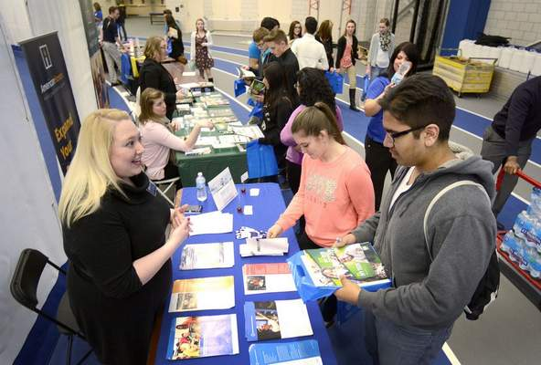FILE: Sonja Cronin, left, of ITT Technical Institute chats with Wayne High School students about their educational futures at the Northeast Indiana College Fair.