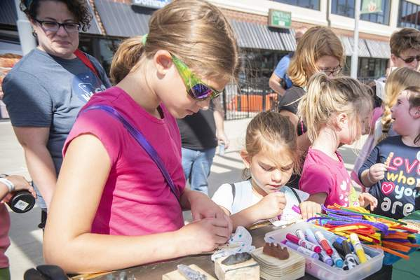Brett Luke | The Journal Gazette  Makayla Volz, 9, left, and Samantha Volz, 6, work on crafts at this year's Discover Girl Scouting event at Parkview Field Sunday afternoon.
