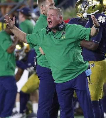 Notre Dame head coach Brian Kelly argues a call in the second half of an NCAA football game against Michigan, in South Bend. (AP Photo/Paul Sancya)