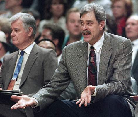 FILE - In this May 18, 1995, file photo, Chicago Bulls coach Phil Jackson argues a call against his team, as he sits next to assistant coach Tex Winter during the second quarter of an NBA basketball playoff game against the Orlando Magic in Chicago. Winter, the innovative Triangle Offense pioneer who assisted Jackson on 11 NBA championship teams with the Bulls and the Los Angeles Lakers, has died. He was 96. Kansas State University said Winter died Wednesday, Oct. 10, 2018, in Manhattan, Kan. (AP Photo/Fred Jewell, File)