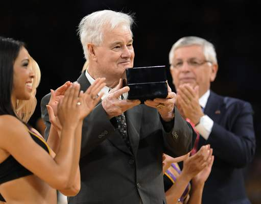 FILE - In this Oct. 27, 2009, file photo, Los Angeles Lakers assistant coach Tex Winter receives his NBA championship ring during the second half of the team's NBA basketball game against the Los Angeles Clippers in Los Angeles. At rear is NBA Commissioner David Stern. (AP Photo/Gus Ruelas, File)