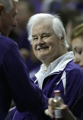 FILE - In this Jan. 24, 2015, file photo, Former Kansas State basketball coach Tex Winter smiles when greeted in the crowd during the first half of the team's NCAA college basketball game against Oklahoma State in Manhattan, Kan. Winter, the innovative Triangle Offense pioneer who assisted Phil Jackson on 11 NBA championship teams with the Chicago Bulls and Los Angeles Lakers, has died. He was 96. Kansas State University said Winter died Wednesday, Oct. 10, 2018, in Manhattan, Kan. (AP Photo/Orlin Wagner, File)