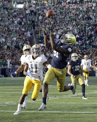 Notre Dame wide receiver Miles Boykin (81) makes the game winning touchdown catch against Pittsburgh defensive back Dane Jackson during the second half of an NCAA college football game, Saturday, Oct. 13, 2018, in South Bend, Ind. Notre Dame won 19-14. (AP Photo/Darron Cummings)