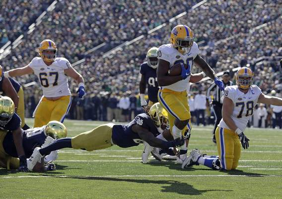 Pittsburgh's Qadree Ollison (30) runs out of tackle by Notre Dame's Asmar Bilal for a touchdown run during the first half of an NCAA college football game, Saturday, Oct. 13, 2018, in South Bend, Ind. (AP Photo/Darron Cummings)