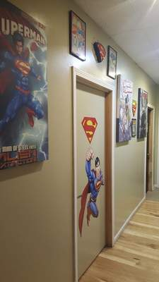Some of the super hero swag in the hallway near the restrooms at Two Bandits Brewing Co. in Hicksville, Ohio.