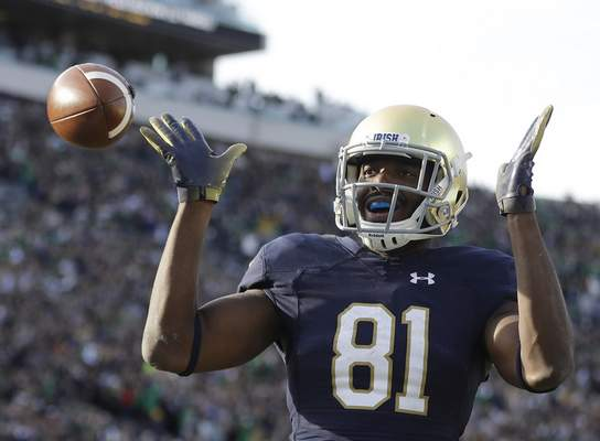 Notre Dame's Miles Boykin celebrates after making the game-winning catch during the second half against Pittsburgh, Saturday in South Bend. Notre Dame won 19-14 and moved up to No. 4 in this week's AP Poll. (AP Photo/Darron Cummings)