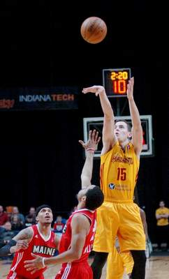 Samuel Hoffman | The Journal Gazette: Nick Zeisloft of the Mad Ants shoots a three-pointer against Maine in a December 2016 game at Memorial Coliseum. The club today acquired three draft picks from Long Island in exchange for Zeisloft's returning player rights.