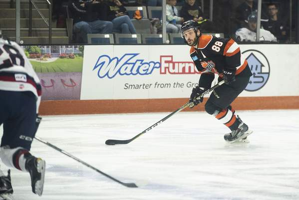 Brett Luke | The Journal Gazette  Justin Hodgman of the Komets looks for an open teammate during the first period against Kalamazoo at the Coliseum on Saturday.