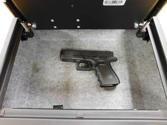 Brian Francisco | The Journal Gazette A Glock 19 handgun is shown in a safe at the Jay County School Corp. administration building.