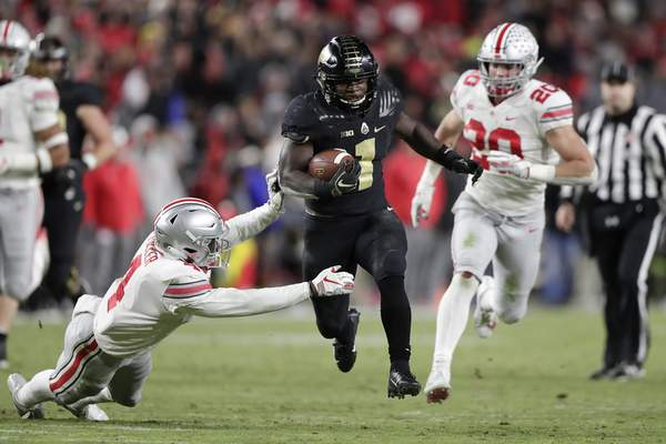 Purdue running back D.J. Knox runs for a touchdown during the second half against Ohio State on Saturday. The Boilers' win over the Buckeyes was one of the only major upsets in college football this week. (AP Photo/Michael Conroy)