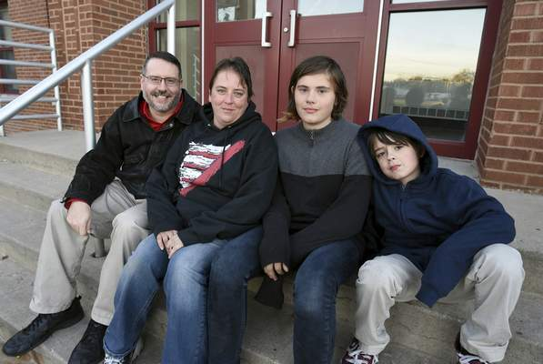 Rachel Von | The Journal Gazette  Jason Headlee, seated with his wife, Nicole, and sons Keegan, 13, and Lucas, 9, believes lack of parenting has led to much of the violence seen at schools.