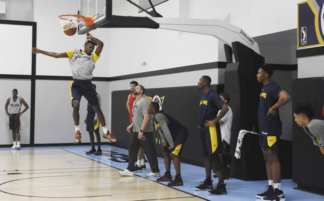 Rachel Von   The Journal Gazette  Mad Ants' Theo Johnson dunks the ball during the first practice at the ASH Centre on Monday October 22, 2018.