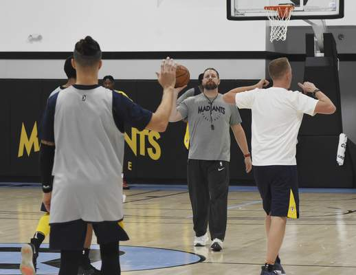 Rachel Von   The Journal Gazette  Mad Ants' coach Steve Gansey works with players during the Mad Ants first practice at the ASH Centre on Monday October 22, 2018.