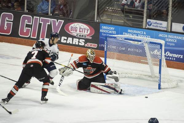 Brett Luke | The Journal Gazette  Zachary Fucale of the Komets deflects a shot during the first period against Kalamazoo at the Coliseum on Saturday.