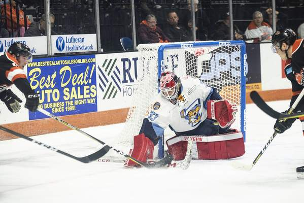 Brett Luke | The Journal Gazette Komets attack the Toledo goal during the first period at the Coliseum Friday night.