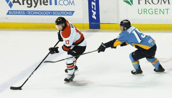 Justin A. Cohn   The Journal Gazette  Komets forward Justin Kea, left, is chased as he enters the offensive zone at the Huntington Center by Dylan Sadowy of the Toledo Walleye on Saturday night in Toledo, Ohio.