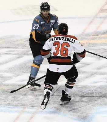 Justin A. Cohn   The Journal Gazette  Komets forward Anthony Petruzzelli tries to cut across center ice at the Huntington Center in Toledo, Ohio, on Saturday night but he's blocked by the Toledo Walleye's A.J. Jenks.