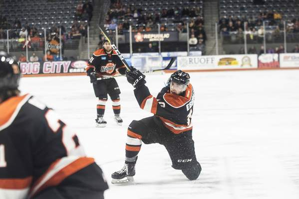 Brett Luke | The Journal Gazette  Thomas Ebbing of the Komets takes a shot against Toledo during the first period at the Coliseum on Friday.