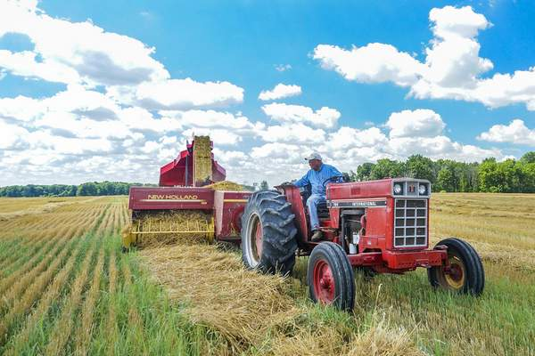 Mike Moore | The Journal Gazette Straw supplier for the Fort Wayne Children's Zoo Stan Kruse of Kruse Farms bales straw using his new bale accumulator near his farm on Leesburg Road on Wednesday afternoon.