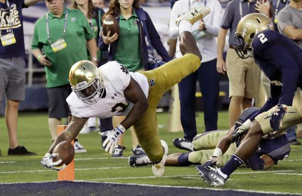 Notre Dame running back Dexter Williams leaps into the end zone for a touchdown against Navy on Saturday in San Diego. The Irish are No. 3 in this week's AP Poll and No. 2 in Dylan Sinn's poll. (AP Photo/Gregory Bull)