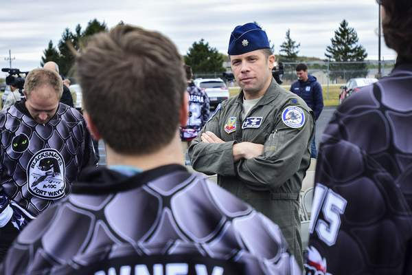 Mike Moore | The Journal Gazette Members of the Fort Wayne Komets hockey team speak with 122nd Fighter Wing pilot LtCol Bryan Jandorf after a press conference where the Komets unveiled their new jersey design for Military Appreciation weekend at Heritage Park on Tuesday.