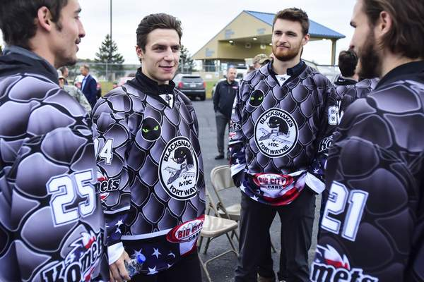 Mike Moore | The Journal Gazette Komets forwards Kevin Miller, left and Aidan Muir, right hang out with teammates in their new Blacksnakes jerseys before a press conference at Heritage Park on Tuesday.
