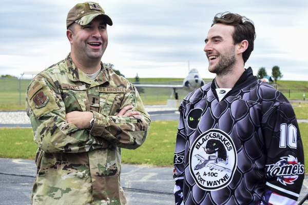 Mike Moore | The Journal Gazette Komets forward Thomas Ebbing and 122nd Fighter Wing Public Affairs Officer 1LT Aaron Pence share a laugh after a press conference where the Komets unveiled their new jersey design for Military Appreciation weekend at Heritage Park on Tuesday.