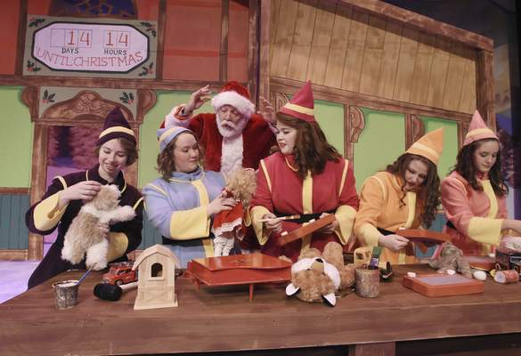 Jeffery Moore as Santa gives some instruction to a group of elves.