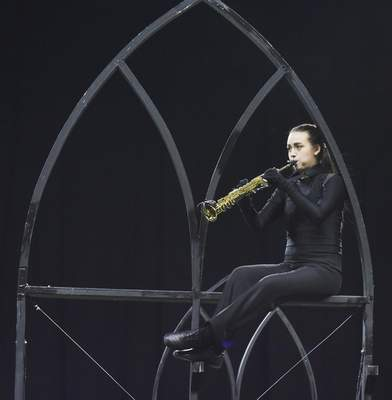 """Senior Isabel Heibeck of the Concordia Lutheran  Marching Cadets  plays the soprano saxophone during the band's show """"Heavenly Light."""" Concordia finished eighth in ClassC."""