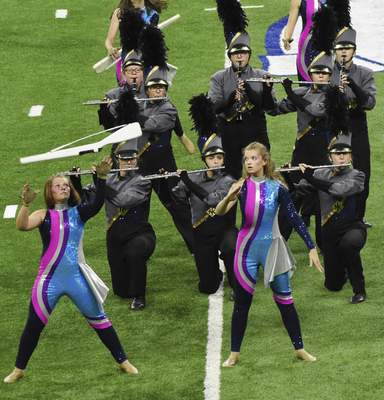 """Members of the Norwell Marching Knights perform during their show, titled """"Beyond."""" The band finished sixth in Class C."""