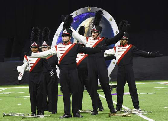 """Members of the North Side marching band perform  """"Spaced Out"""" on Saturday."""