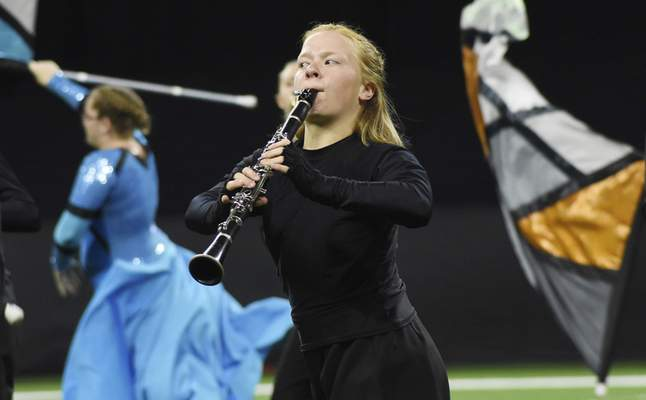 Rachel Von | The Journal Gazette  Anna Duly of the Concordia Lutheran Fort Wayne marching band performs during the show titled Heavenly Light at the ISSMA State Marching Band Finals at Lucas Oil Stadium in Indianapolis on Saturday.