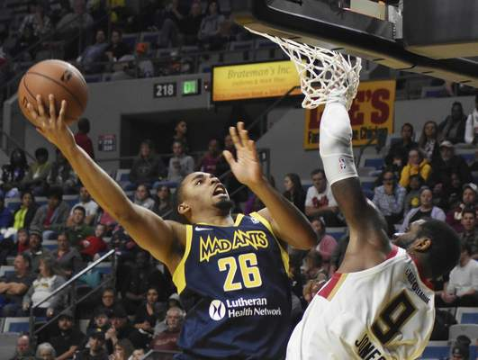 Rachel Von | The Journal Gazette  Mad Ants' Ben Moore jumps up to shoot the ball as Bayhawks' Terrence Jones tries to block his shot during the third quarter at the Coliseum on Friday.