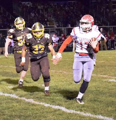 Elizabeth Wyman | The Journal Gazette Adam Central's Colton Yergler runs toward the end zone after taking a handoff in the first quarter Friday against Monroe Central.