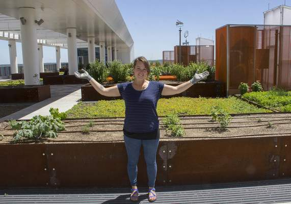 Courtesy | Eskenazi Health Rachel White stands amid produce grown on The Sky Farm at Eskenazi Health in Indianapolis.