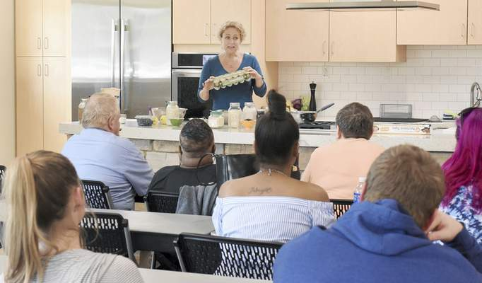 Rachel Von | The Journal Gazette  Kelley Marvin talks about eggs during her cooking demonstration for adults from Easter Seals at Jackson R. Lehman Family YMCA on Wednesday July 25, 2018.