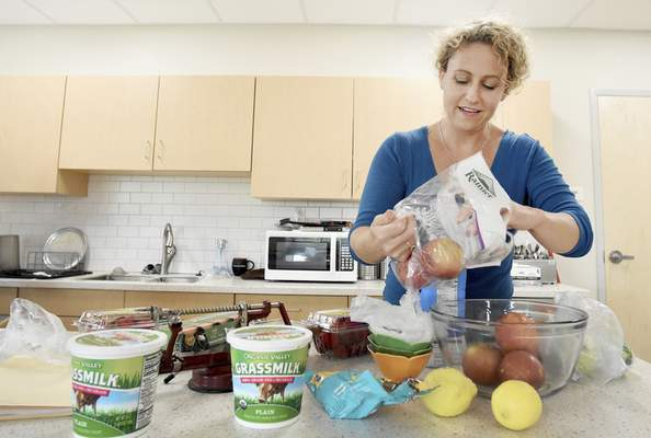 Rachel Von | The Journal Gazette  Kelley Marvin works on getting ingredients ready for her cooking demonstration for adults from Easter Seals at Jackson R. Lehman Family YMCA on Wednesday July 25, 2018.