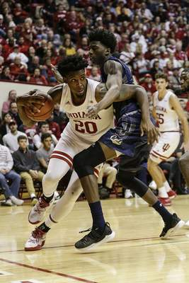 Indiana forward De'Ron Davis drives to the hoop in an 80-35 win over Montana State on Friday. The undefeated Hoosiers welcome No. 24 Marquette to Assembly Hall tonight. (AP Photo/AJ Mast)