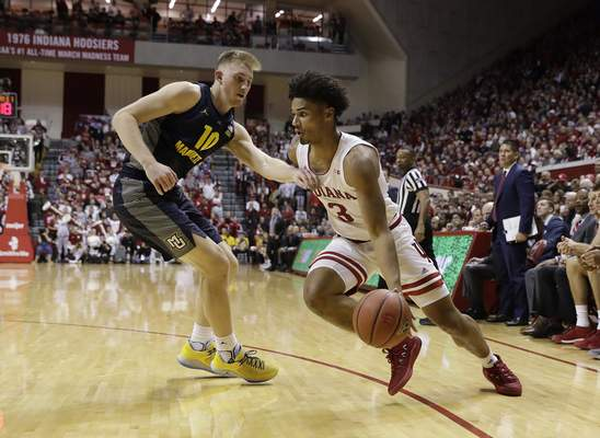 Indiana's Justin Smith goes to the basket past Marquette's Sam Hauser on Wednesday in Bloomington. Indiana won 96-73 against the No. 24 team in the country. (AP Photo/Darron Cummings)