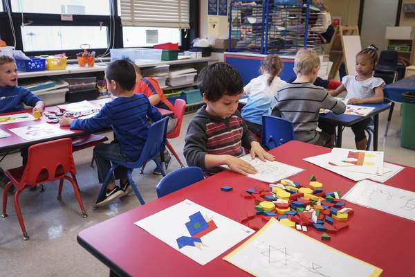 Mike Moore | The Journal Gazette  A student in Lacey Metzger's pre-k class works with geometric wooden blocks in her classroom at Franke Park Elementary on Monday 11.12.2018