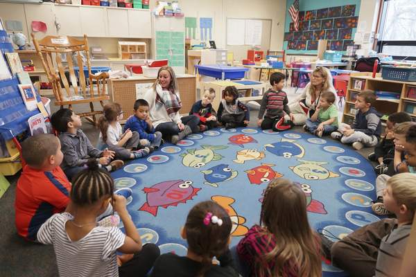 Mike Moore | The Journal Gazette  Pre-school teacher Lacey Metzger interacts with her students while sitting in a circle in her classroom at Franke Park Elementary on Monday 11.12.2018