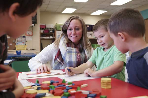 Mike Moore | The Journal Gazette  Pre-school teacher Lacey Metzger interacts with students while working with geometric wooden blocks in her classroom at Franke Park Elementary on Monday 11.12.2018