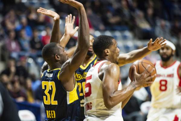 Brett Luke   The Journal Gazette  Davon Reed, left, and Ben Moore, middle, play defense for the Mad Ants against Nick King of the Maine Red Claws this season at Memorial Coliseum. Reed has been called up to the Indiana Pacers and Moore signed by the San Antonio Spurs.