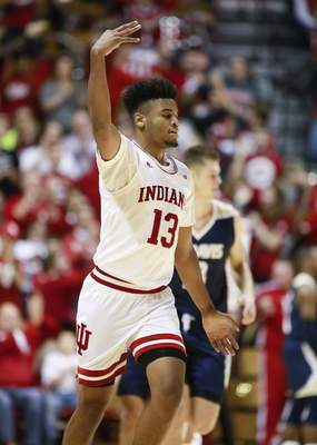Indiana's Juwan Morgan celebrates after making one of his five 3-pointers against UC-Davis. Morgan led the Hoosiers with a season-high 31 points and Indiana came from behind to win 76-62. (Jeremy Hogan/The Herald-Times via AP)