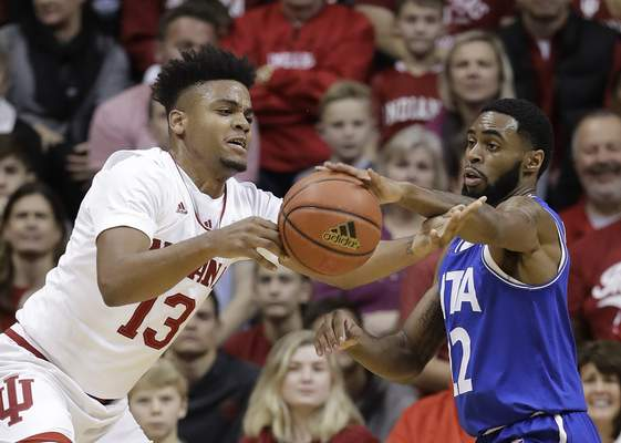 Indiana's Juwan Morgan battles for a loose ball against UT-Arlington on Tuesday. Morgan will lead the depleted Hoosiers against UC-Davis on Friday night. (AP Photo/Darron Cummings)