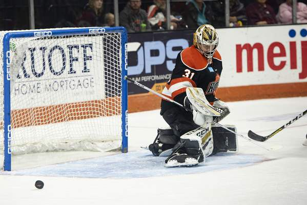 Brett Luke | The Journal Gazette Zachary Fucale of the Komets deflects an attempted shot made by Cincinnati during the second period at the Memorial Coliseum Saturday night.