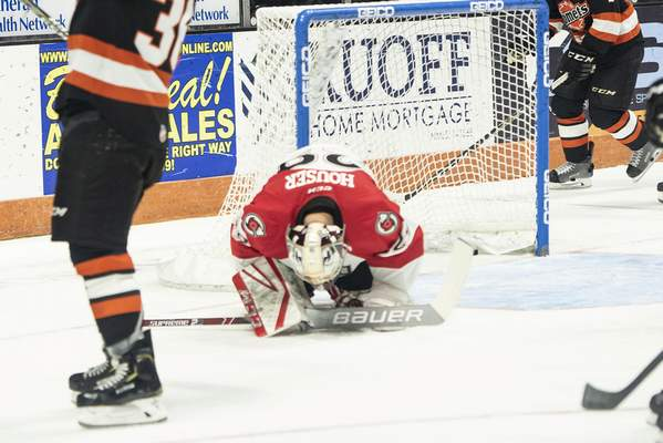 Brett Luke | The Journal Gazette Michael Houser, of Cincinnati and former Komet's goalie, hangs his head as Komets score a second consecutive goal within 20 seconds of each other during the first period at the Memorial Coliseum Saturday night.